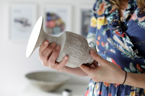 Marijke Varrall-Jones, Director of Maak Contemporary Ceramics studying a Lucie Rie Vase